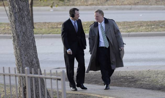 File - In the Feb. 12, 2014 file photo, Victor Holmes, left, and partner Mark Phariss, right, arrive at the U.S. Federal Courthouse, in San Antonio, where a federal judge is expected to hear arguments in a lawsuit challenging Texas' ban on same-sex marriage. Republican attorneys general across the U.S. are fighting court rebukes of same-sex marriage bans in their states. But Texas' Greg Abbott is doing so against extraordinary personal ties: Phariss, one of the gay men challenging the law here is an old friend. (AP Photo/Eric Gay, File)