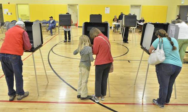 Voters cast their vote at El Dorado Community School in El Dorado at Santa Fe, N,M, Tuesday morning, Nov., 2012. After a grinding presidential campaign, Americans are heading into polling places across the country. (AP Photo/The Santa Fe New Mexican, Clyde Mueller)