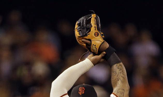 San Francisco Giants third baseman Pablo Sandoval stretches and blows a bubble while stretching in the eighth inning of their baseball game Tuesday, July 9, 2013, in San Francisco. (AP Photo/Eric Risberg)