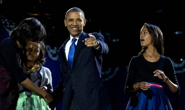 President Barack Obama, accompanied by first last Michelle Obama and daughters Malia and Sasha arrive at the election night party Wednesday, Nov. 7, 2012, in Chicago. Obama defeated Republican challenger former Massachusetts Gov. Mitt Romney. (AP Photo/Carolyn Kaster)