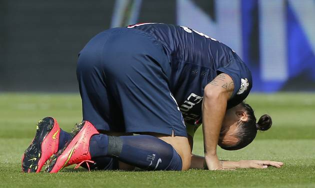 FILE -   In this Aug.16, 2014 file photo, Paris Saint Germain's Swedish Zlatan Ibrahimovic, kneels on the pitch after being injured, during a French League One soccer match, PSG against Bastia, at the Parc des Princes stadium, in Paris. Instead of catching up with the Premier League or the Bundesliga, a growing catalog of signs indicates that French Ligue 1 clubs _ with the exception of Qatari-owned Paris Saint-Germain _ are slipping further behind rivals in England, Germany, Spain and Italy. Russia, sinking hundreds of billions of rubles of public and private money into the 2018 World Cup and its football clubs, is also now snapping at France's heels. Armed with an awesome collection of players, owners with seemingly bottomless pockets, and by far the biggest revenues and crowds of Ligue 1, PSG has quickly become a European force. But it could be a long, long time _ perhaps never _ before the likes of Marseille, Saint-Etienne, Monaco or Reims play another European Cup final. (AP Photo/Michel Euler, File)