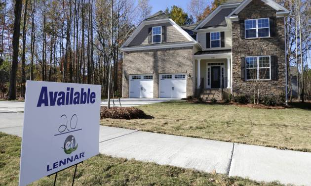 FILE - In this Nov. 14, 2013, file photo, a home is advertised for sale in Matthews, N.C. U.S. home prices barely rose in November from the previous month and year-over-year gains slowed, reflecting declines in sales in the fall, according to a report from real estate data provider CoreLogic, Tuesday, Jan. 7, 2014. (AP Photo/Chuck Burton, File)