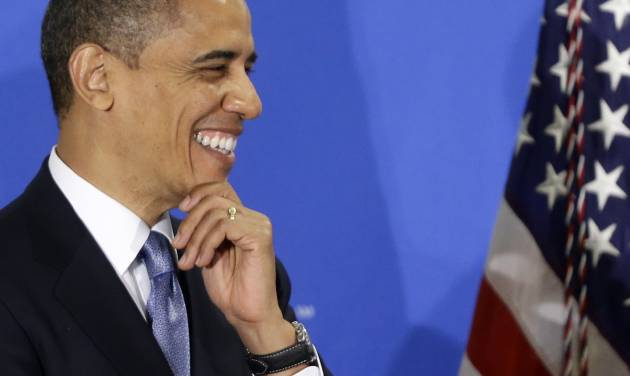 President Barack Obama smiles as he is introduced by Jim McNerney, chief executive officer of The Boeing Company, before speaking about the fiscal cliff during an address before the Business Roundtable, an association of chief executive officers, Wednesday, Dec. 5,2012, in Washington. (AP Photo/Charles Dharapak)