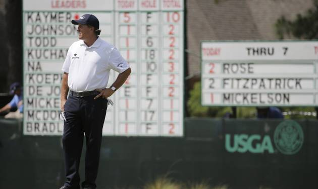 Phil Mickelson waits to putt on the eighth hole during the second round of the U.S. Open golf tournament in Pinehurst, N.C., Friday, June 13, 2014. (AP Photo/Eric Gay)
