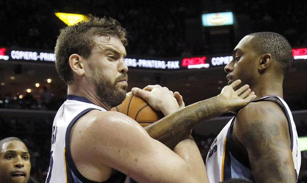 Memphis Grizzlies forward Rudy Gay (22) fights for a loose ball with Atlanta Hawks guard Louis Williams (3) in the first half of an NBA basketball game on Saturday, Dec. 8, 2012, in Memphis, Tenn. (AP Photo/Lance Murphey)