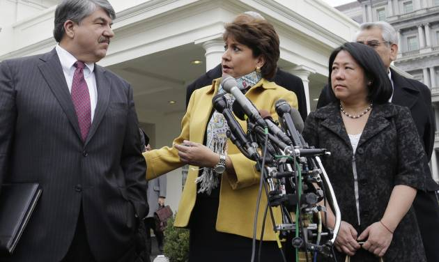 From left, AFL-CIO President Richard Trumka; Janet Murguia, National Council of la Raza; and Mee Moua of the Asian American Justice Center, speak to reporters outside the White House in Washington, Tuesday, Feb. 5, 2013, following a meeting with President Obama about immigration reform and the economy.  (AP Photo/Charles Dharapak)