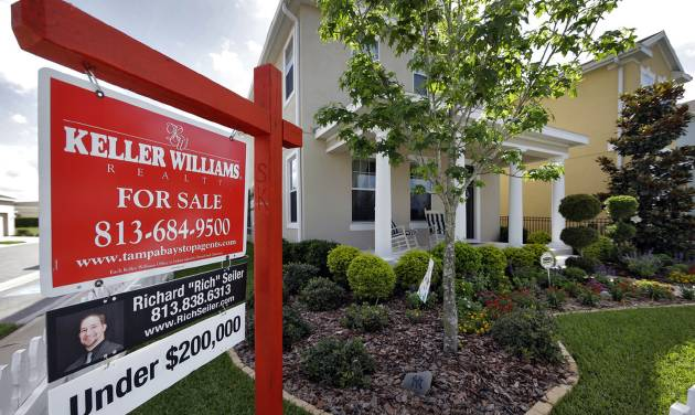 This May 14, 2014 photo shows a new home for sale in the Winthrop subdivision in Riverview, Fla. Freddie Mac reports on average U.S. mortgage rates for this week on Thursday, June 5, 2014. (AP Photo/Chris O'Meara)