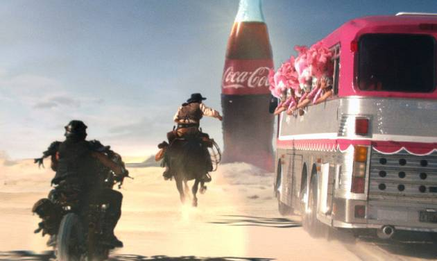This frame grab provided by Coca Cola, shows a moment in the Super Bowl 2013 Coca Cola campaign.  You don't have to be a football player to be a part of the action on Super Bowl Sunday. Coca-Cola is asking people to vote for an online match between three groups competing for a Coke on Game Day.   (AP Photo/Coca Cola)