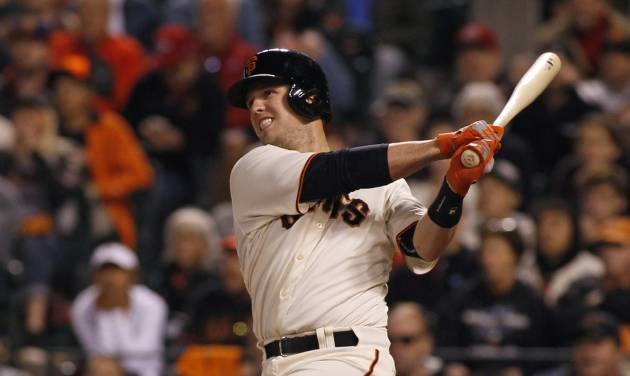San Francisco Giants' Buster Posey hits an RBI double to tie the game against the Cincinnati Reds during the ninth inning of a baseball game, Saturday, June 28, 2014, in San Francisco.  (AP Photo/George Nikitin)