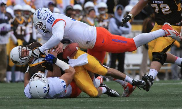 Boise State's Darren Koontz (95) top, and Beau Martin (53), bottom, sack Wyoming quarterback Brett Smith causing a fumble in the second half of an NCAA college football game, Saturday, Oct. 27, 2012 at War Memorial Stadium in Laramie, Wyo. Boise State won 45-14. (AP Photo/The Idaho Statesman, Chris Butler) LOCAL TV OUT (KTVB 7) MANDATORY CREDIT