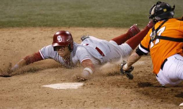OU's Hector Lorenzana slides home past OSU's Gage Green in the 18th inning of a Bedlam baseball game between Oklahoma State University and the University of Oklahoma in Stillwater, Tuesday, April 15, 2014. Photo by Bryan Terry, The Oklahoman