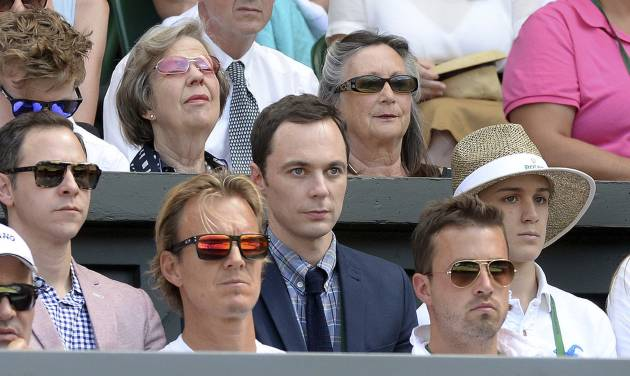 U.S. actor Jim Parsons, centre, watches from  the players box duirng the Wimbledon women's semifinal match between Canada's Eugenie Bouchard and  Romania's Simona Halep at the All England Lawn Tennis Championships in Wimbledon, London,  Thursday July 3, 2014. (AP Photo/Anthony Devlin/PA)  UNITED KINGDOM OUT