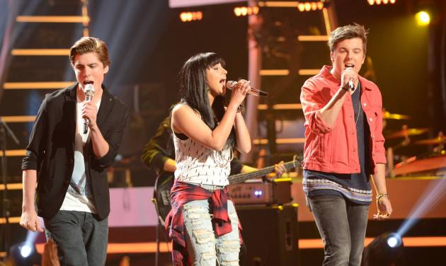 """In this photo provided by FOX Broadcasting, from left, Sam Woolf, Jena Irene and Alex Preston perform on the April 30, 2014, episode of the 13th season of """"American Idol."""" 21st Century Fox reports quarterly earnings on Wednesday, May 7, 2014. (AP Photo/FOX Broadcasting, Michael Becker)"""