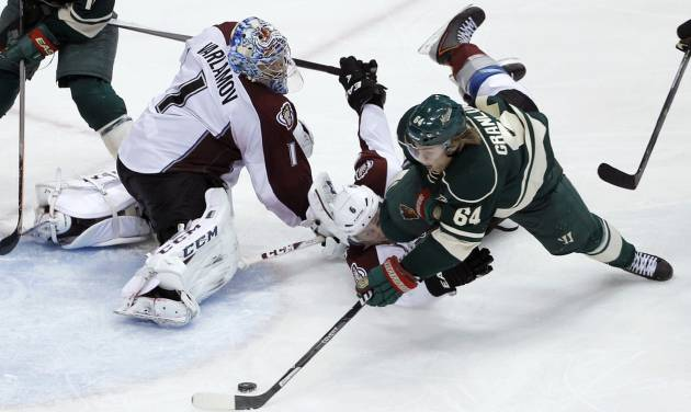 Minnesota Wild center Mikael Granlund (64), of Finland, shoots the puck around Colorado Avalanche defenseman Erik Johnson (6) and  Avalanche goalie Semyon Varlamov (1), of Russia, to score the game-winning goal during overtime of Game 3 of an NHL hockey first-round playoff series in St. Paul, Minn., Monday, April 21, 2014. The Wild won 1-0 in overtime. (AP Photo/Ann Heisenfelt)