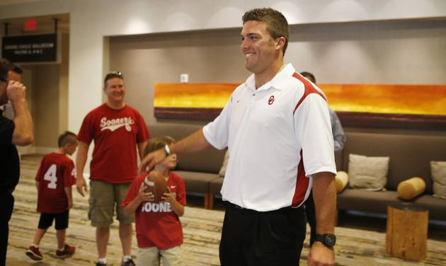 University of Oklahoma quarterback Blake Bell meets fans at the Sooner Caravan at the Hyatt Wichita. Bell was there with head coach Bob Stoops and a few other coaches. Bell is a Wichita native and Bishop Carroll graduate. (June 19, 2013) Photo by Jaime Green, The Wichita Eagle ORG XMIT: B73183861Z.1
