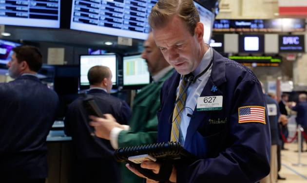 Trader Michael Smyth works on the floor of the New York Stock Exchange Monday, April 28, 2014. Stocks are mostly higher in early trading as traders hope for another blockbuster merger in the health-care industry. (AP Photo/Richard Drew)