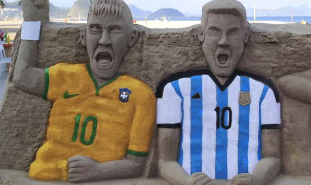 A sand sculpture featuring soccer players, Neymar of Brazil, left, and Lionel Messi of Argentina, on Copacabana beach in Rio de Janeiro, Brazil, Monday, June 2, 2014. The 2014 Brazil World Cup is set to begin in a few days, with Brazil and Croatia competing in the opening match on June 12. (AP Photo/Hassan Ammar)