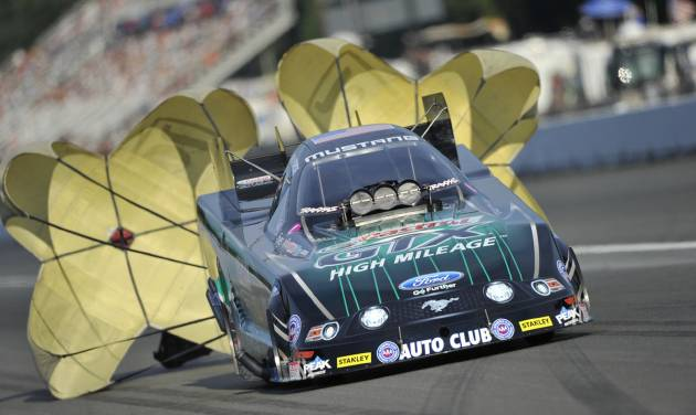 n this photo provided by NHRA, John Force pulls the parachutes to slow his Funny Car after his leading qualifying run Friday, Aug. 1, 2014, at the O'Reilly Auto Parts NHRA Northwest Nationals drag races at Pacific Raceways in Kent, Wash. Force led qualifying on Friday with a performance of 4.085 seconds at 308.07 mph. (AP Photo/NHRA, Teresa Long)