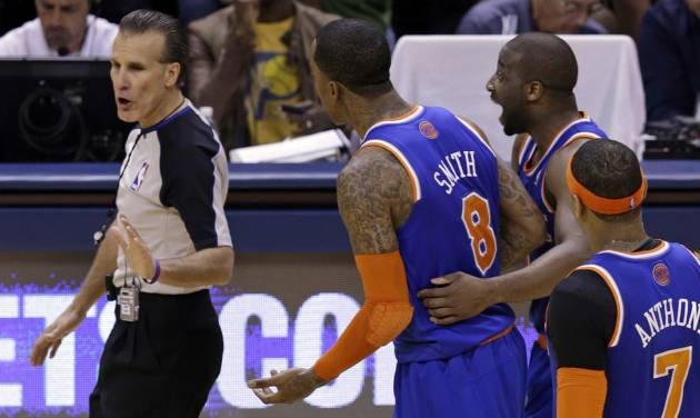 New York Knicks guard J.R. Smith, center, is held by guard Raymond Felton as he appeals to referee Ken Mauer, left, after receiving a technical foul during the second quarter of Game 6 of the Eastern Conference semifinal NBA basketball playoff series against the Indiana Pacers in Indianapolis, Saturday, May 18, 2013. (AP Photo/Michael Conroy)