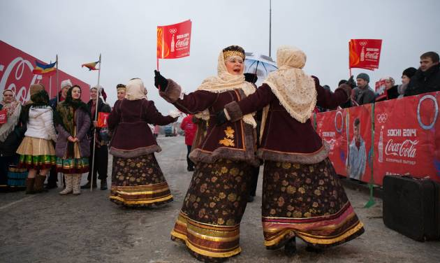In this photo provided by Olympictorch2014.com, performers dressed in folk costumes dance during a welcome ceremony of the Olympic torch relay in Rostov-on-Don, a city about 1,000 kilometers (600 miles) south of Moscow, Russia, Wednesday, Jan. 22, 2014. The 65,000-kilometer (40,389 mile) Sochi torch relay, which started on Oct. 7, is the longest in Olympic history. The torch has traveled to the North Pole on a Russian nuclear-powered icebreaker and has even been flown into space. (AP Photo/Olympictorch2014.com)