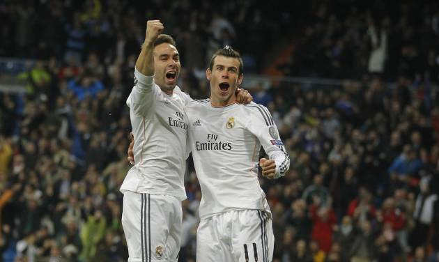 Real's Gareth Bale celebrates scoring the opening goal with Real's Daniel Carvajal, left, during a Champions League quarterfinal first leg soccer match between Real Madrid and Borussia Dortmund at the Santiago Bernabeu   stadium in Madrid, Spain, Wednesday April 2, 2014. (AP Photo/Paul White)