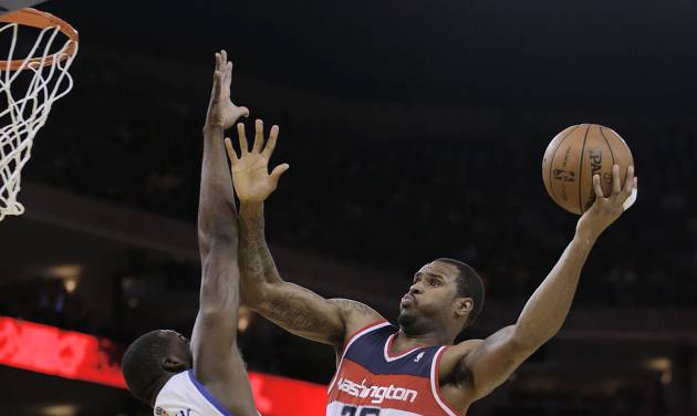 Washington Wizards' Trevor Booker, right, shoots over Golden State Warriors' Draymond Green (23) during the first half of an NBA basketball game, Tuesday, Jan. 28, 2014, in Oakland, Calif. (AP Photo/Ben Margot)