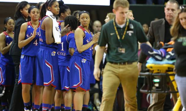 Kansas players look on as teammate Kansas guard Keyla Morgan (32), right, is removed from the court after suffering an injury against Baylor in the second half of an NCAA college basketball game on Sunday, Jan. 5, 2014, in Waco, Texas.  Baylor won 75-55. (AP Photo/Rod Aydelotte)