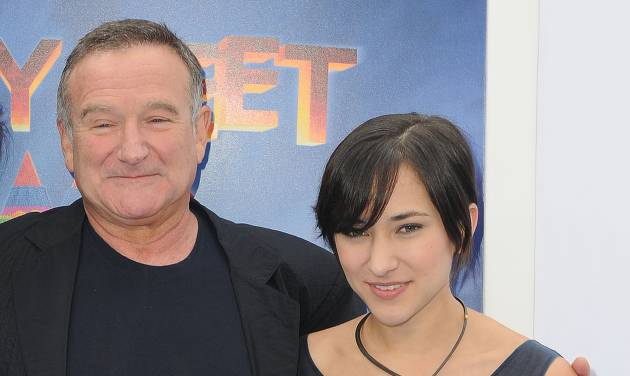"""FILE - This Nov. 13, 2011 file photo shows actor Robin Williams, left, and his daughter, Zelda at the premiere of  """"Happy Feet Two"""" in Los Angeles. Williams, whose free-form comedy and adept impressions dazzled audiences for decades, has died in an apparent suicide. He was 63. The Marin County Sheriff's Office said Williams was pronounced dead at his home in California on Monday, Aug. 11, 2014. The sheriff's office said a preliminary investigation showed the cause of death to be a suicide due to asphyxia. (AP Photo/Katy Winn, File)"""