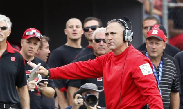 Rutgers head coach Kyle Flood signals to his players from the sidelines during the second half of an NCAA college football game against Connecticut in Piscataway, N.J., Saturday, Oct. 6, 2012. Rutgers won 19-3. (AP Photo/Mel Evans)