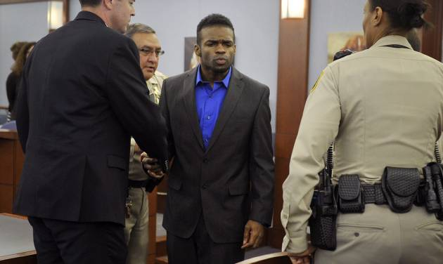 "Jason Omar Griffith, center, blows a kiss to his mother before being lead away and after a guilty verdict was read during his murder trial at the Regional Justice Center on Thursday, May 22, 2014, in Las Vegas. Griffith was convict of second degree murder of his girlfriend and Luxor ""Fantasy"" dancer Deborah Flores Narvaez in December 2010. (AP Photos/Las Vegas Review-Journal, David Becker)"