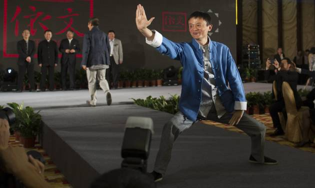 In this April 21, 2013 photo, Jack Ma, chairman of the world's largest e-commerce group Alibaba, poses during a show at the annual Summit of China Green Companies in Kunming, in southwestern China's Yunnan province. Even before Alibaba went online, the founder talked about making the fledgling e-commerce company a global player. (AP Photo) CHINA OUT