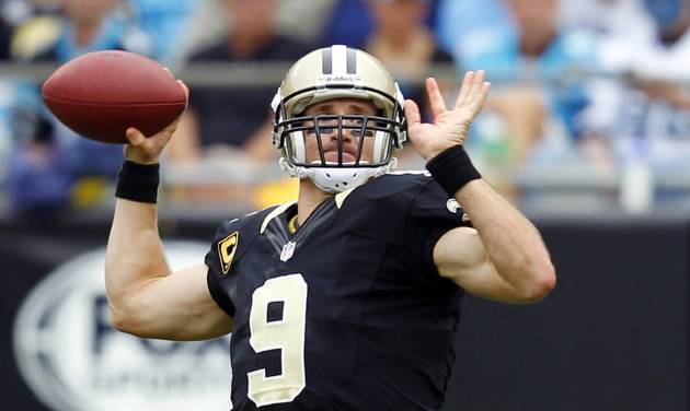 New Orleans Saints quarterback Drew Brees (9) looks to pass against the Carolina Panthers during the third quarter of an NFL football game in Charlotte, N.C., Sunday, Sept. 16, 2012. (AP Photo/Chuck Burton)