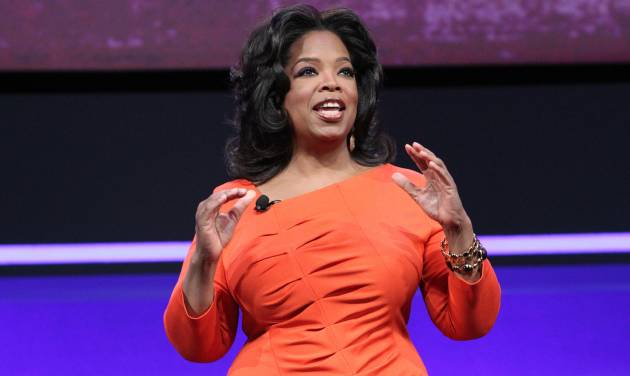 FILE - In this April 14, 2011 file publicity image released by OWN, TV personality and media mogul Oprah Winfrey presents at the OWN: Oprah Winfrey Network portion of the Discovery Communications Upfront at Jazz at Lincoln Center in New York. Winfrey's interview with Lance Armstrong is more than an illustration of a hero athlete tumbling from the heights. It's also a pivotal moment for a famous media figure on the way back. Winfrey's OWN network is showing signs of life after a well-documented rocky start, and the Armstrong interview offered a chance for many more viewers to tune in. The first half of the interview aired Thursday Jan. 17, 2013, with a second part Friday. (AP Photo/OWN, George Burns)  MANDATORY CREDIT: GEORGE BURNS/OWN