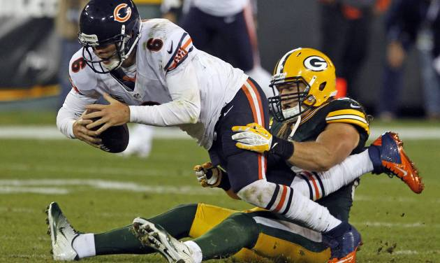 FILE - This Sept. 13, 2012 file photo shows Green Bay Packers outside linebacker Clay Matthews sacking Chicago Bears quarterback Jay Cutler during an NFL football game in Green Bay, Wis. Cutler's outburst aside, an all-too-familiar scene played out for the Bears during last week's loss to Green Bay. Their quarterback took a beating.(AP Photo/Matt Ludtke)