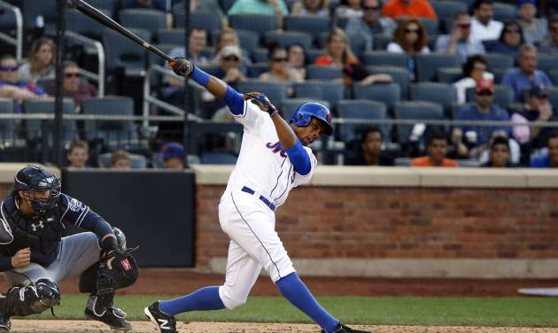 New York Mets' Curtis Granderson, right, swings and misses during the seventh inning of a baseball game against the San Diego Padres, Saturday, June 14, 2014, in New York. (AP Photo/Jason DeCrow)