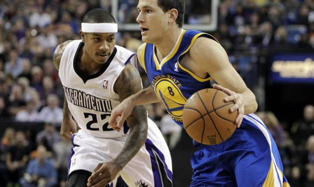 Golden State Warriors guard Nemanja Nedovic,  right, of Serbia, drives against Sacramento Kings guard Isaiah Thomas during the first quarter of an NBA basketball game in Sacramento, Calif., Sunday, Dec. 1, 2013. (AP Photo/Rich Pedroncelli)