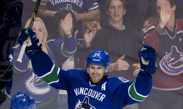 Vancouver Canucks left wing Daniel Sedin (22) celebrates his goal during the second period of NHL hockey action against the Edmonton Oilers in Vancouver, British Columbia, Saturday, Oct. 5, 2013. (AP Photo/The Canadian Press, Jonathan Hayward)