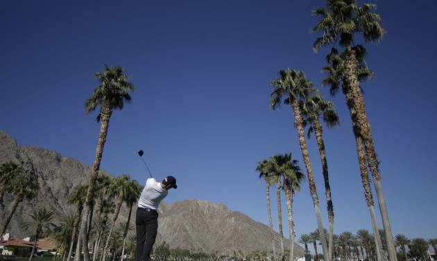 Zach Johnson hits from the 13th tee during a practice round for the Humana Challenge golf tournament on the Palmer Private course at PGA West, Wednesday, Jan. 15, 2014, in La Quinta, Calif. (AP Photo/Chris Carlson)