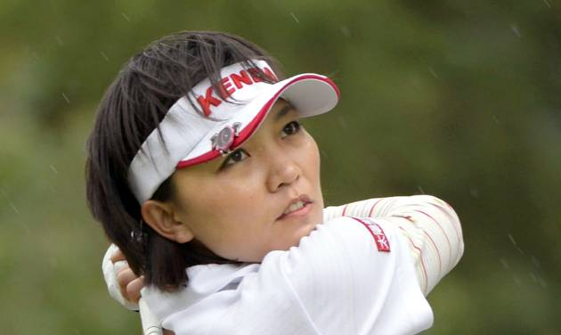 Taiwan's Teresa Lu watches her tee shot on the second hole during the final round of the Mizuno Classic golf tournament in Shima, Mie prefecture, western Japan Sunday, Nov. 10, 2013. Lu won the Mizuno Classic on Sunday. (AP Photo/Kyodo News) JAPAN OUT, MANDATORY CREDIT