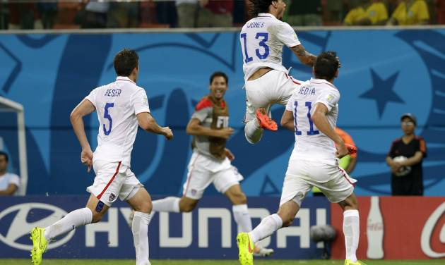 United States' Jermaine Jones (13) celebrates after scoring his side's first goal during the group G World Cup soccer match between the United States and Portugal at the Arena da Amazonia in Manaus, Brazil, Sunday, June 22, 2014. (AP Photo/Martin Mejia)