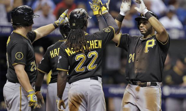 Pittsburgh Pirates' Pedro Alvarez (24) high fives teammates, including Andrew McCutchen (22) and Travis Snider (23) after hitting a three-run home run off Tampa Bay Rays starting pitcher Alex Cobb during the third inning of an interleague baseball game, Monday, June 23, 2014, in St. Petersburg, Fla. (AP Photo/Chris O'Meara)