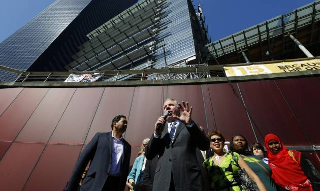 Seattle Mayor Ed Murray, center speaks Monday, June 2, 2014, at a rally outside Seattle City Hall after the Seattle City Council passed a $15 minimum wage measure in Seattle. (AP Photo/Ted S. Warren)