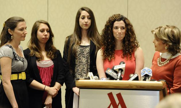 University of Connecticut student Rosemary Richi, at podium, answers questions from the media as attorney Gloria Allred, right, Kylie Angell, left, Erica Daniels, second from left, and Carolyn Luby, look on, during a news conference, Friday, July 18, 2014. The University of Connecticut will pay nearly $1.3 million to settle a federal lawsuit filed by five women who claimed the school responded to their sexual assault complaints with indifference, the two sides announced Friday.  (AP Photo/Jessica Hill)