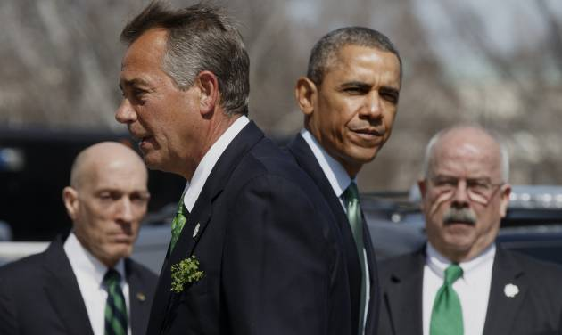 President Barack Obama and House Speaker John Boehner of Ohio part ways following a St. Patrick's Day luncheon on Capitol Hill in Washington, Friday, March 14, 2014. The political rivals came together to host a gathering for Taoiseach Enda Kenny of Ireland. They are flanked by House Sergeant at Arms Paul Irving, left, and Senate Sergeant at Arms Terrance Gainer.  (AP Photo/J. Scott Applewhite)