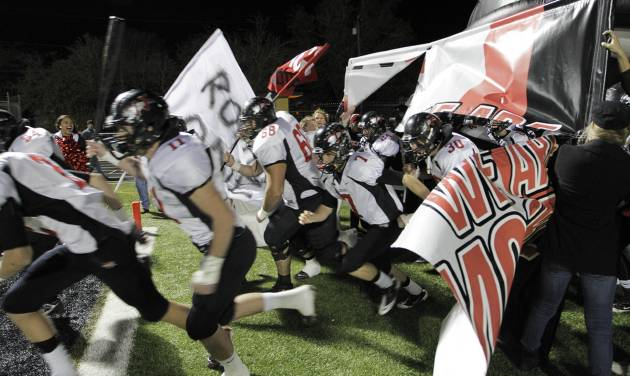 The Westmoore Jaguars take the field before a 2011 game against Midwest City.  Photo from The Oklahoman Archives