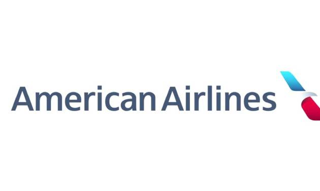 """This image released Thursday, Jan. 17, 2013, by American Airlines shows the company's new logo. The airline showed off the first plane bearing a new logo and paint job at Dallas--Fort Worth International Airport on Thursday. The familiar red, white and blue stripes along the side of the fuselage are gone, replaced by a new logo and """"American"""" in large letters on the silver body. (AP Photo/American Airlines)"""