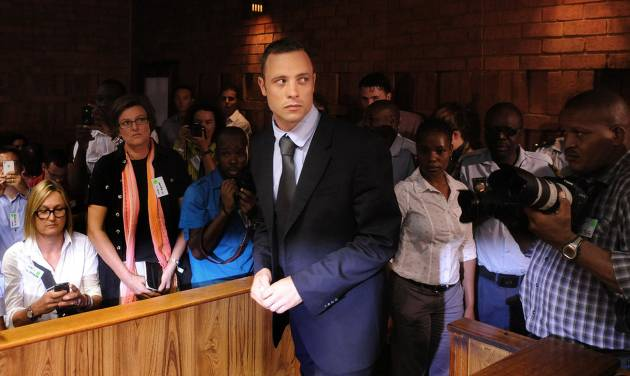 """FILE - In this Feb. 22, 2013 file photo, Olympic athlete Oscar Pistorius arrives for a bail hearing in the shooting death of his girlfriend, Reeva Steenkamp. Pistorius' representatives on Wednesday, Feb. 27, 2013 named the substance found in his bedroom after the shooting death of his girlfriend as Testis compositum, and say it is an herbal remedy used """"in aid of muscle recovery."""" South African police say they found needles in Pistorius' bedroom along with the substance, which they initially named as testosterone. Prosecutors later withdrew that statement identifying the substance and said it had been sent for laboratory tests. (AP Photo, File)"""