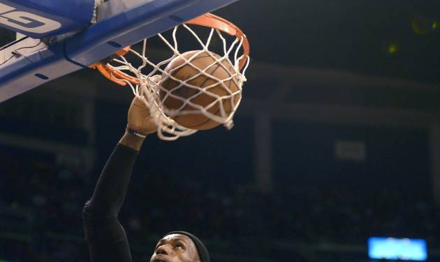 Miami Heat forward LeBron James (6) dunks the ball in front of Orlando Magic forward Hedo Turkoglu (15) during the first half of an NBA basketball game in Orlando, Fla., Monday, Dec. 31, 2012.(AP Photo/Phelan M. Ebenhack)
