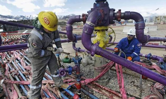 Workers tend to a well head in March 2013 during a hydraulic fracturing operation at an Encana Oil & Gas Inc. gas well in western Colorado. AP File Photos    -  AP file photo