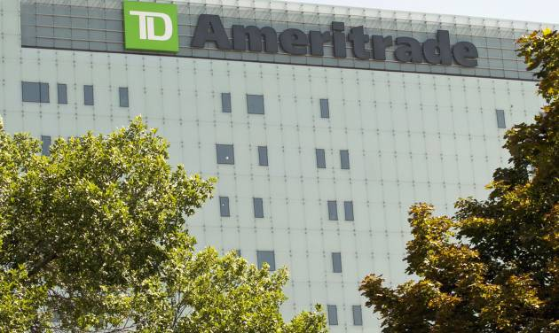 FILE - In this Monday, July 16, 2012, file photo, TD Ameritrade's new corporate headquarters stands in Omaha, Neb. A surge in trading activity at the end of 2013 helped online brokerage TD Ameritrade record a 31 percent jump in its quarterly profit as the economy continued improving and Congress avoided another budget stalemate. (AP Photo/Nati Harnik, File)